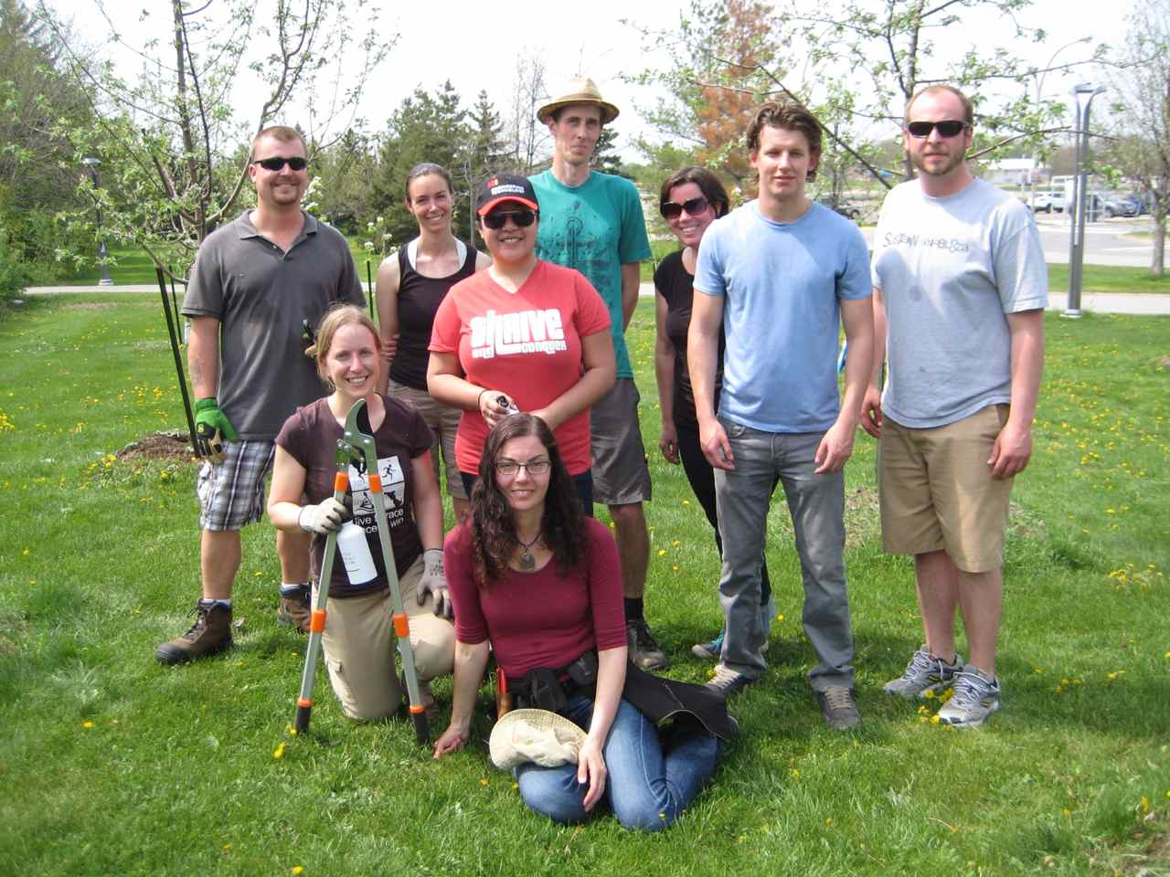Mohawk college staff and volunteers learn fruit tree pruning with Susan Poizner (centre front) in the campus orchard.