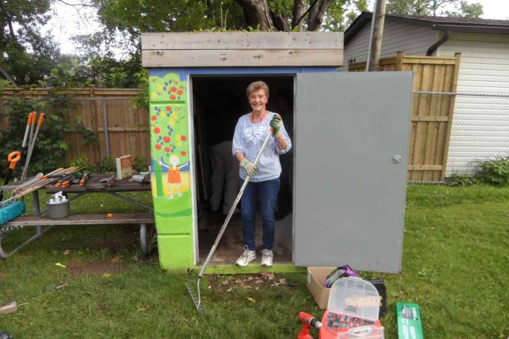 Lynn cleans up the shed in the Ben Nobleman Park Community Orchard in Toronto