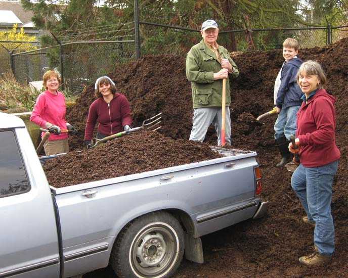Volunteers bring a truck load of composted