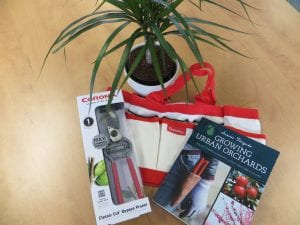 Graduates received free tools and a tool bag from Corona and a free copy of award-winning fruit tree care book Growing Urban Orchards